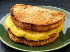 A toasted scrambled egg breakfast sandwich (USA)