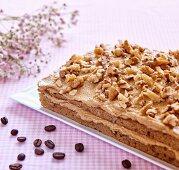Coffee cake with caramel cream and walnuts