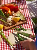 Vegetables being prepared for barbecuing