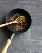A pan of roasted coriander seeds