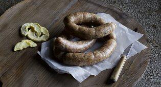 Homemade calvados sausage with dried apples
