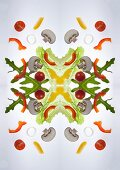 A digital composition of mirrored images of of a mixed vegetable salad