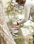 A woman making camping food