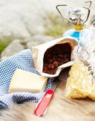Ingredients for camping food: cheese and bolognese sauce