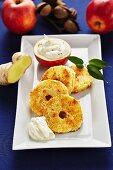 Fried apple and coconut rings with ginger and quark cream