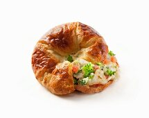 A croissant with scrambled egg white and broccoli