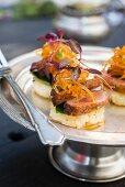 Potato rosti with cress, orange-glazed duck and candied grapefruit zest