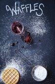 Waffles, icing sugar and mixed berries