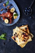 Blueberry waffles with bananas and bacon