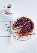 Lemon cheesecake with blueberries, sliced