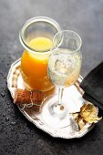 A glass of sparkling wine with orange juice