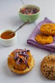 Vegan burgers made from chickpeas, millet and sweet potatoes on wholemeal rolls with red cabbage salad and mango sauce