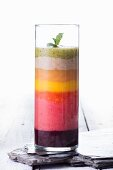 A colourful layered smoothie