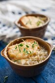French onion soup with toast, Gruyere cheese and fresh thyme