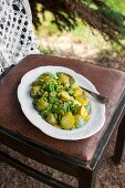 Potatoes with broad beans, yellow courgette and basil pesto
