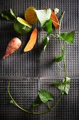 Sweet potatoes and citrus fruit with a sprig of ivy