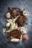 Pork fillets on the bone with creamy whiskey mushrooms