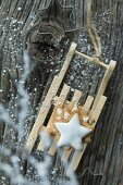 A stack of cinnamon stars on a mini wooden sledge (seen from above)