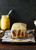 Passion fruit cake with icing on a wire rack