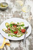 Grilled courgettes strips with soya beans, tomatoes and basil