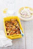 Chicken drumsticks with piri piri, roast potatoes and coleslaw (Portugal)
