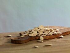 Pumpkin seeds on a chopping board