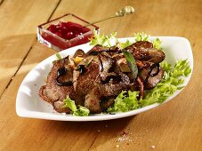 Rabbits liver salad with lingonberry compote and balsamic vinegar