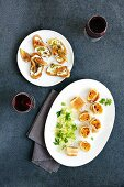 Crostini topped with ricotta, and pumpkin strudel with Tyrolean bacon