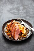 Duck breast with spiced jus and chickpea cream