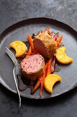 Veal fillets on spiced carrots with polenta moons