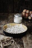 Legumes on a tart base for blind baking