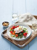Green asparagus salad with oven roasted tomatoes and a poached egg