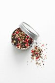 A tin of colourful peppercorns