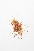 A spice mixture with pink peppercorns