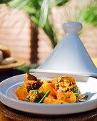 Oriental tagine made with stuffed garden vegetables