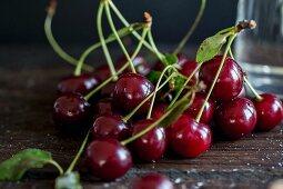 Sour cherries on a dark surface