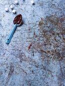 Chocolate glaze on a spoon with marshmallows
