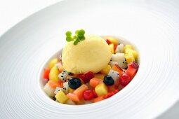 Fruit salad with vanilla ice cream