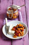 Persimmon chutney with red onions, raisins, ginger and chilli with a piece of gorgonzola