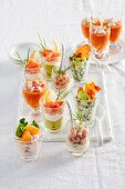 Various appetisers in glasses for a Christmas party