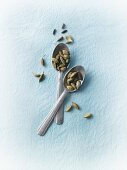 Cardamom pods on spoons