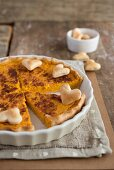 A rustic pumpkin tart decorated with pastry hearts