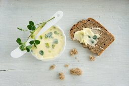 Hops clover butter in a small dish and spread on a slice of bread