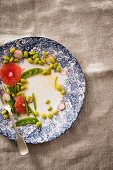 A half-eaten grapefruit and edamame bean salad with a sweet-and-spicy ginger sauce