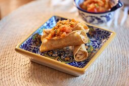 Tacos with chicken and tomato salsa