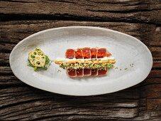 Sushi with tuna fish, chilli mayonnaise and herbs