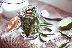 Pickled bird's eye chillis in a flip-top jar
