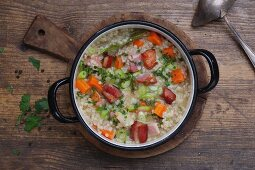 Barley stew with bacon and carrots