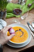 Pumpkin soup with pumpkin oil for an Easter lunch
