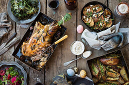 Lamb leg with various side dishes for Easter (top view)